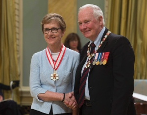 Governor General David Johnston invests Dr Janet Rossant as a Companion of the Order of Canada. (Photo: Adrian Wyld /Canadian Press)